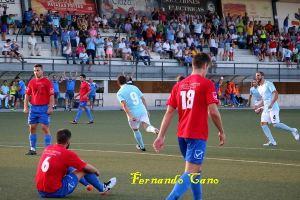 Miguel Ruiz celebra uno de sus dos goles al Adra | Fernando Cano
